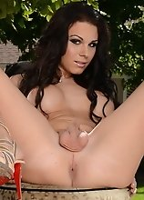 Tempting tgirl Ashley George posing outdoors
