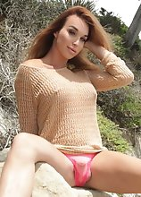 Seductive Jonelle strips outdoors