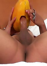 Horny Shemale fucking a Papaya and cumming inside it