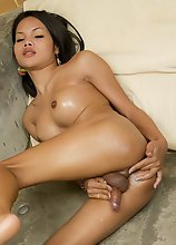Oiled up Ladyboy Honey naked and hard in stone bathtub