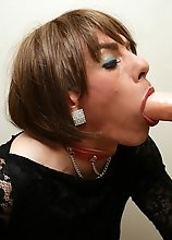 Zoe wearing sexy nylons and sucking on a dildo hard