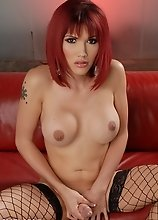 Hot redhead Eva Lin stripping and masturbating