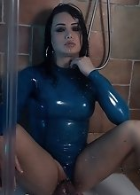 Bianka in sexy tight blue latex gets hard and horny on the shower