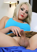 Hot Blonde Transsexual Babe with a shaved cock and balls