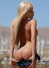 Stunning TS goddess Kimber James posing in the desert