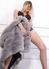 Sexy Angelina removes her fur coat to expose her massive throbbing package