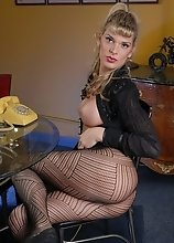 Angelina loves a black dress and the feel of fishnets rubbing against her strong dick